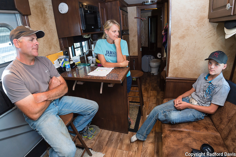 Dan, Jessica, and Dexter cool off in their trailer a few hours before the Friday evening events begin. While Jessica doesn't compete in rodeo, she does ride. The family owns 11 horses and attends nearly 30 rodeos a year, about half of which are in Iowa.