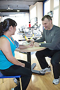 Professional Personal Trainers Michel Pelletier and Svetlana Pelletier train one of their clients at the Metropolitan Tower fitness facility in Vancouver, British Columbia, Canada. Photo Credit: Greg Eymundson / insight-photography.com