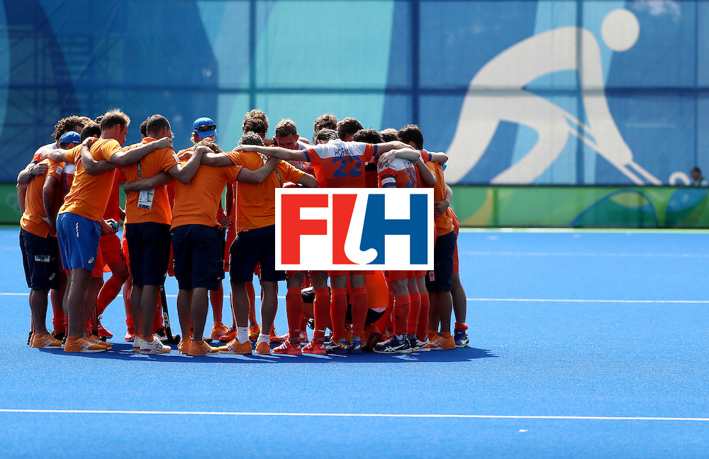 RIO DE JANEIRO, BRAZIL - AUGUST 18:  Team Netherlands huddles after being defeated by Germany in a penalty shootout during the Men's Hockey Bronze medal match at the Olympic Hockey Centre on Day 13 of the 2016 Rio Olympic Games on August 18, 2016 in Rio de Janeiro, Brazil.  (Photo by Sean M. Haffey/Getty Images)