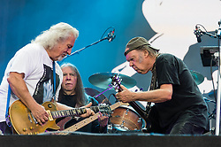 "© Licensed to London News Pictures. 12/07/2014. London, UK.   Neil Youngand Crazy Horse  performing live at Hyde Park as part of the British Summer Time series of outdoor concerts.In this picture - Neil Young (right), Frank Sampredo (left), Rick Roses (centre).   Crazy Horse is a rock band long associated with Neil Young,  consisting of members Rick Roses, (bass, vocals), Ralph Molina (drums, vocals), Frank ""Poncho"" Sampedro ( guitar, organ, keyboards).  Photo credit : Richard Isaac/LNP"