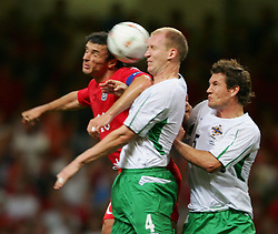 CARDIFF, WALES - Wednesday, September 8, 2004: Wales' Gary Speed in action against Northern Ireland's Colin Murdock (L) and Mark Williams during the Group Six World Cup Qualifier at the Millennium Stadium. (Pic by David Rawcliffe/Propaganda)