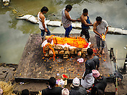 04 MARCH 2017 - KATHMANDU, NEPAL:  A Hindu cremation on the ghats at Pashupatinath UNESCO World Heritage Site in Kathmandu.    PHOTO BY JACK KURTZ