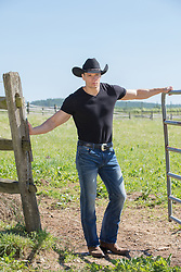 good looking cowboy on a ranch