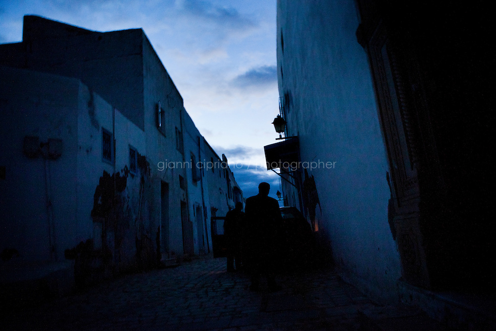 Kairouan, Tunisia - 18 December, 2011: Said Ferjani, 57, senior member of the political and communication bureau of the Nahda (Renaissance) party, walks after the dawn prayer in the streets of his hometown Kairouan, Tunisia on 18 December, 2011. In the 24 October 2011 Tunisian Constituent Assembly election, the first elections since the Tunisian Revolution, the party won 40% of the vote, and 89 of the 217 assembly seats, far more than any other party. Said Ferjani started his activism in the Negra mosque of his hometown Kairouan when he was 16 years old, debating on politics, philosophy, economy and world events. In 1989 former dictator Zine El Abidine Ben Ali turned against Nahda (or Ennahda) and jailed 25,000 activists. Said Ferjani was jailed and tortured. He then flew Tunisia and moved to the UK. He came back to Tunisia after 22 years, after former dictator Ben Ali flew the country.<br /> <br /> Gianni Cipriano for The New York Times