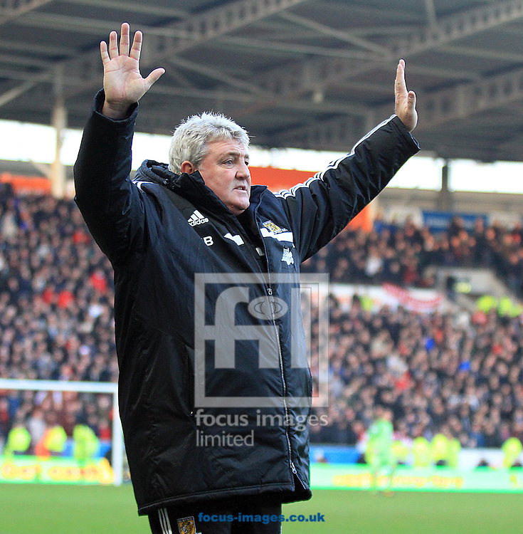 Picture by Richard Gould/Focus Images Ltd +44 7855 403186<br /> 26/12/2013<br /> Steve Bruce, manager of Hull City throws his hands up as he appeals to the ref during the Barclays Premier League match at the KC Stadium, Kingston upon Hull.