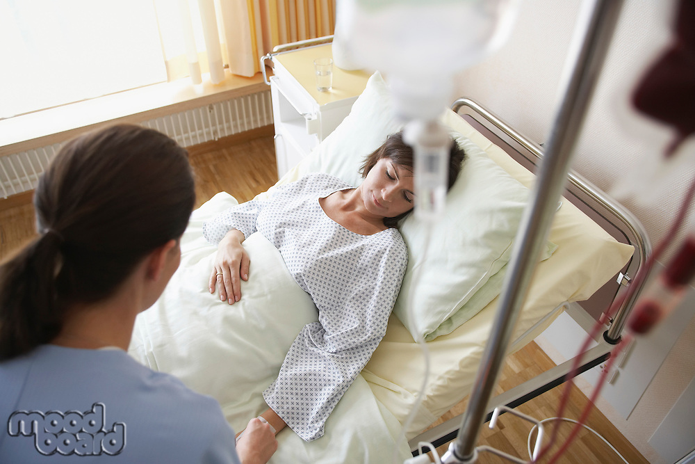 Nurse With Patient in Hospital Room high angle view