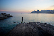 Children play ont he rocks at sunset in Ipanema, Rio de Janeiro, Brazil. Picture by Andrew Tobin/Focus Images Ltd +44 7710 761829<br /> 27/06/2014
