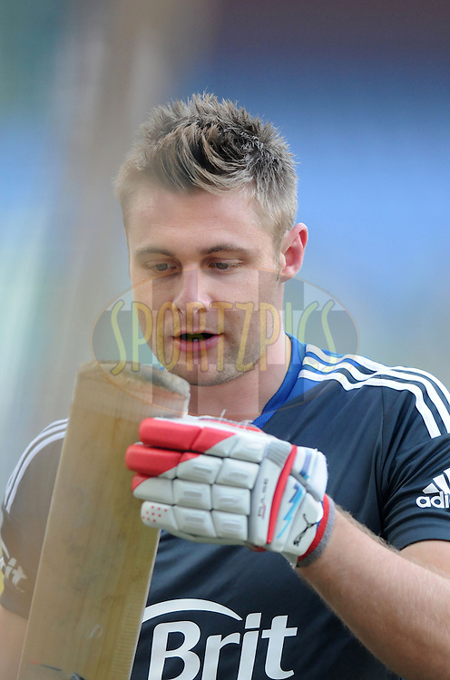 Luke Wright of England has acloser look at his bat during a practice session before the start of the  the second Airtel T20 Match between India and England held at Wankhede stadium in Mumbai on the 22th December 2012..Photo by  Pal Pillai/BCCI/SPORTZPICS .