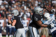 Oakland Raiders quarterback Derek Carr (4) looks for an open receiver against the Tennessee Titans at Oakland Coliseum in Oakland, Calif., on August 26, 2016. (Stan Olszewski/Special to S.F. Examiner)