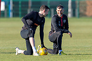 Aaron Hughes (#16) of Heart of Midlothian (right) jokes with John Souttar (#4) during the Heart of Midlothian training session ahead of the match against Motherwell, at Oriam Sports Performance Centre, Edinburgh, Scotland on 15 February 2019.