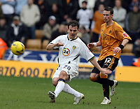 Photo: Rich Eaton.<br /> <br /> Wolverhampton Wanderers v Leeds United. Coca Cola Championship. 24/02/2007. Robbie Blake left of Leeds clears watched by Michael McIndoe right of Wolves