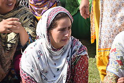 August 17, 2017 - Pulwama, India - A Kashmiri woman bursts into tears as she watches the funeral of slain rebel Mohd Ayoub Lone Alias Ayoub Lelhari  at her native place Lelhari In Pulwama district. Thousands of Kashmiri Muslim mourners marched with the body of slain rebel Ayoub Lelhari, during his last rites at his native village Lelhar In Pulwama District (Credit Image: © Abbas Idrees/Pacific Press via ZUMA Wire)
