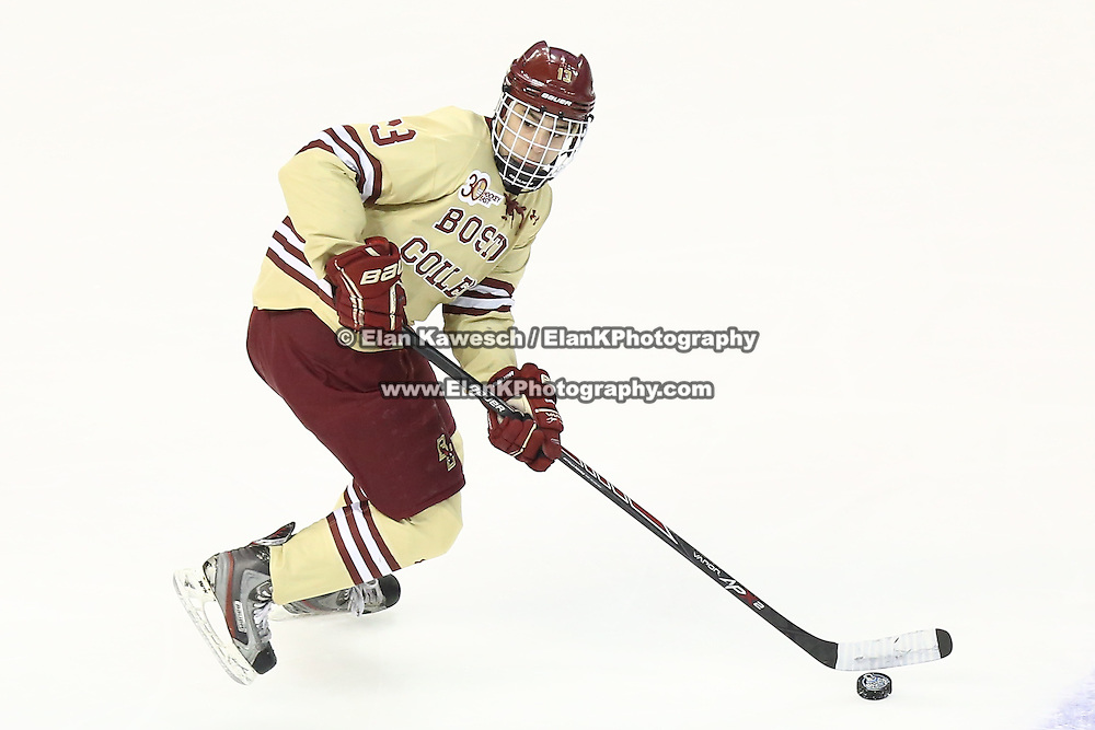 Johnny Gaudreau #13 of the Boston College Eagles with the puck during The Beanpot Championship Game at TD Garden on February 10, 2014 in Boston, Massachusetts. (Photo by Elan Kawesch)