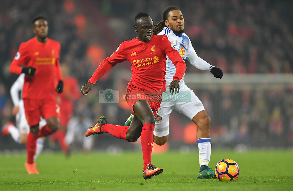 Liverpool's Sadio Mane (left) and Sunderland's Jason Denayer in action during the Premier League match at Anfield, Liverpool.