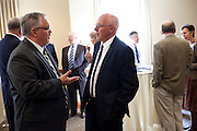 (insert name), left, socializes with Hans-Joerg Stiehler (director of the Institute for Communications and Media Studies, Leipzig) during the memorandum reception. Leipzig University President Beate A. Schücking  and Ohio University President McDavis renewed a Memorandum of Understanding between LU and Ohio University in the Multicultural Center's multipurpose room in Baker Center on Monday, September 24, 2012..Photo by Chris Franz.