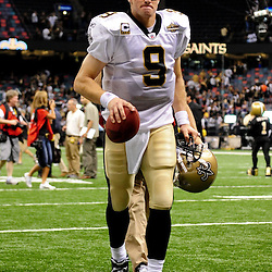 September 9, 2010; New Orleans, LA, USA;  New Orleans Saints quarterback Drew Brees (9) runs off the field following a 14-9 victory over the Minnesota Vikings in the NFL Kickoff season opener at the Louisiana Superdome.  Mandatory Credit: Derick E. Hingle