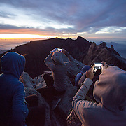 Hikers on Low's Peak for sunrise, Kinabalu Summit Trail, Kinabalu National Park, Borneo, Malaysia.