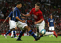 Photo: Paul Thomas.<br /> Manchester United v Inter Milan. Pre Season Friendly. 01/08/2007.<br /> <br /> Michael Carrick (R) of Utd is fouled by Dejan Stankovic.