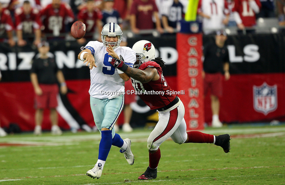 GLENDALE, AZ - OCTOBER 12: Quarterback Tony Romo #9 of the Dallas Cowboys throws an incomplete pass while pressured by Darnell Dockett #90 of the Arizona Cardinals at University of Phoenix Stadium on October 12, 2008 in Glendale, Arizona. The Cardinals defeated the Cowboys 30-24. ©Paul Anthony Spinelli *** Local Caption *** Tony Romo;Darnell Dockett