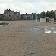 Slecht weer, leeg strand Zomerkade Huizen