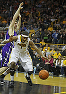 January 12 2010: Iowa Hawkeyes forward Melsahn Basabe (1) loses the ball as Northwestern Wildcats forward John Shurna (24) defends during the first half of an NCAA college basketball game at Carver-Hawkeye Arena in Iowa City, Iowa on January 12, 2010. Northwestern defeated Iowa 90-71.