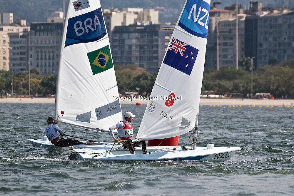 Sam Meech (NZL)  rounds the leeward mark, chasing medal race leader, Robert Scheidt (BRRA) in the Medal Race of the Mens Laser - 2016 Olympic sailing Regatta.<br /> 16 August 2016.<br /> Copyright photo: Richard Gladwell / www.photosport.nz