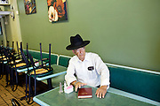 Rabbi Joseph Kaufman (left), a 39-year Miami Beach resident, sits in his friend Melvin Safra's restaurant, Bagel Time in Miami Beach, Florida July 17, 2011. ..Kendrick Brinson/LUCEO