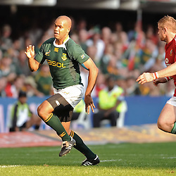JP Pietersen of South Africa chases his kick with Jamie Heaslip of the Lions trying to hold him back.<br /> British&Irish Lions v Springboks - ABSA Stadium - Durban - South Africa. The Springboks won 26-21.