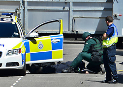 © Licensed to London News Pictures. 30/06/2015. London, UK. Medics attend to a fatality. Members of the emergency service take part in a mocked-up terrorist firearms attack at Aldwych station in central London. The exercise is the biggest to take place in London and is happening a week after dozens of people where killed when a gunman opened fire on a beach in Tunisia.  Photo credit: Ben Cawthra/LNP