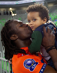 Mory Sidibe kissing his son and wife after the volleyball match between ACH Volley and Lube Banca Marche Macerata (ITA) in 5th Leg of Pool D of 2013 CEV Champions League on December 5, 2012 in Arena Stozice, Ljubljana, Slovenia. ACH defeated Macerata 3-1. (Photo By Vid Ponikvar / Sportida)
