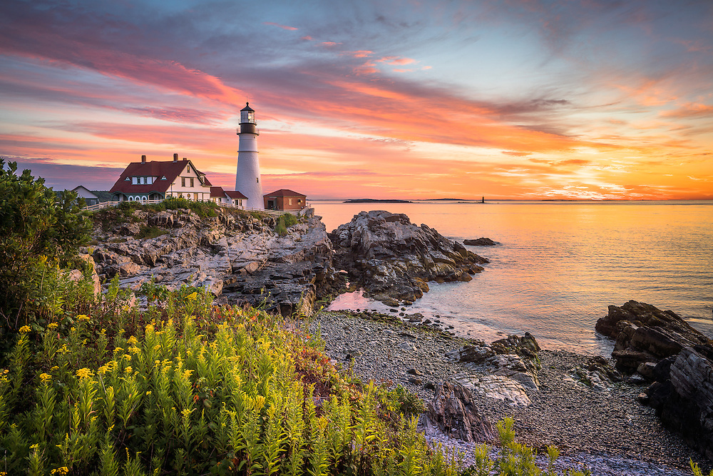 Yesterday's sunrise at Portland Head Light was pretty nice. The challenge was making the best of nearly zero wave action and a very low tide. Instead of a dramatic, stormy sky, we had one of those colorful, peaceful sunrises that feature gentle clouds slinking across the horizon. To impart the peaceful feeling, I included some greenery in my foreground and went for a simple composition.