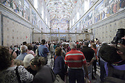 mass tourism inside the Sistine Chapel Rome Vatican Musem