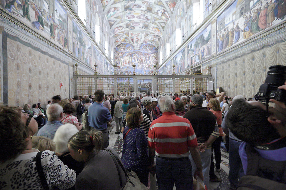 mass tourism inside the Sistine Chapel Rome Vatican Musem