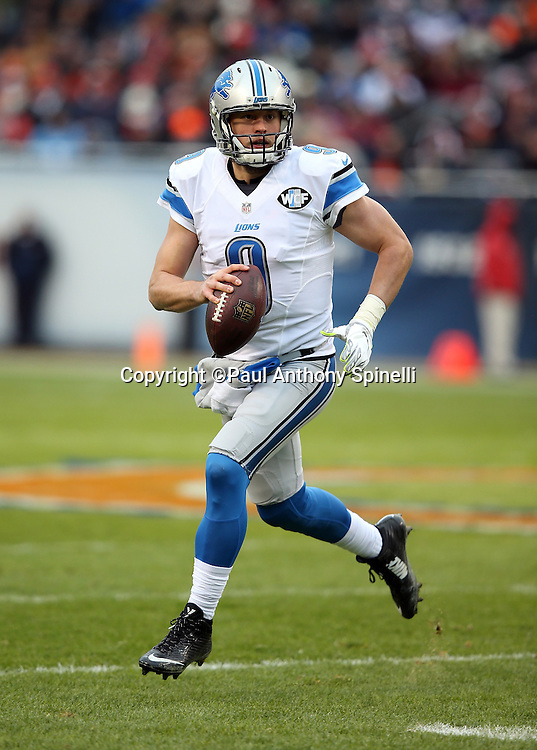Detroit Lions quarterback Matthew Stafford (9) scrambles to his right while looking to pass in the first quarter during the NFL week 17 regular season football game against the Chicago Bears on Sunday, Jan. 3, 2016 in Chicago. The Lions won the game 24-20. (©Paul Anthony Spinelli)