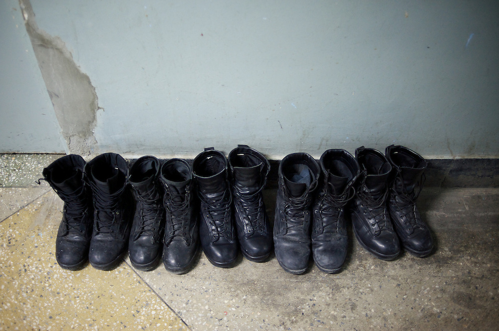 November 14, 2012 - Kabul, Afghanistan: Boots of Afghan National Police (ANP) cadets lined outside the entrance door of one of the barracks at the Afghan Nacional Police Academy...ANP Academy trains 1250 cadets at the time during a period of four years. Every year, five hundred new recruits are selected, out of more than nine thousand of candidates, to join the academy and other five hundred graduate. Fifteen per cent of the recruits are women. (Paulo Nunes dos Santos)