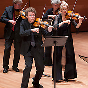 May 1, 2012 - New York, NY :  From left, violinists Gerd-Uwe Klein, Gottfried von der Goltz, Christa Kittel, and Annelies van der Vegt of the Freiburg Baroque Orchestra perform Johann Sebastian Bach's Orchestra Suite No. 1 in C major (before 1725) as part of Lincoln Center's 2011/2012 Great Performers Season at Alice Tully Hall on Tuesday night. CREDIT : Karsten Moran for The New York Times