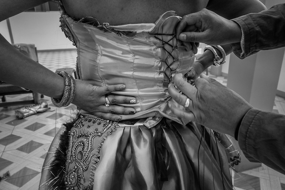 Finishing touches on the elaborate costume.