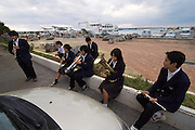 Miyako-jima, Hirara. Youth orchestra warming up with their instruments at the ferry harbour.
