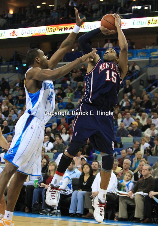 21 January 2009: New Jersey Nets guard Vince Carter (15) shoots over New Orleans Hornets guard Rasual Butler (45) during a 102-92 win by the New Orleans Hornets over the New Jersey Nets at the New Orleans Arena in New Orleans, LA. .