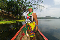 Embera Indian woman in a dugout canoe on the Chagres River, Soberania National Park (near Panama Canal), Panama