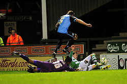 Yeovil Town's Edward Upson beats Wycombe Wanderers' Jordan Archer to the loose ball - Photo mandatory by-line: Dougie Allward/JMP  - Tel: Mobile:07966 386802 04/12/2012 - SPORT - FOOTBALL - Johnstone's Paint Trophy  -  Yeovil  -  Huish Park  -  Yeovil Town V Wycombe Wanderers
