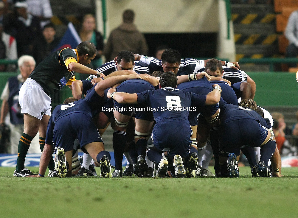 CAPE TOWN, SOUTH AFRICA - 28 February 2009: Referee Jonathan Kaplan sets the scrum during the Super 14 match between the Vodacom Stormers and the Blues held at Newlands Stadium in Cape Town. Photo by: Shaun Roy/ SPORTZPICS