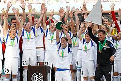 17.05.2014, Rhein-Energie Stadion, Koeln, GER, DFB Pokal, Frauen, 1. FFC Frankfurt vs SGS Essen, Finale, im Bild Kerstin Garefrekes (1. FFC Frankfurt #18) mit dem Pokal, mit Saskia Barusiak (1. FFC Frankfurt #25), Ana-Maria Crnogorceviz (1. FFC Frankfurt #21), Bianca Schmidt (1. FFC Frankfurt #23), Trainer Colin Bell (1. FFC Frankfurt - rechts) // during the woman DFB Pokal final match between 1. FFC Frankfurt and SGS Essen at the Rhein-Energie Stadion in Koeln, Germany on 2014/05/17. EXPA Pictures © 2014, PhotoCredit: EXPA/ Eibner-Pressefoto/ Schueler<br /> <br /> *****ATTENTION - OUT of GER*****