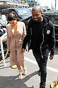 23.MAY.2012. CANNES<br /> <br /> KIM KARDASHIAN AND KANYE WEST EAT ICE CREAM WHILST OUT IN CANNES DURING THE 65TH CANNES FILM FESTIVAL<br /> <br /> BYLINE: EDBIMAGEARCHIVE.CO.UK<br /> <br /> *THIS IMAGE IS STRICTLY FOR UK NEWSPAPERS AND MAGAZINES ONLY*<br /> *FOR WORLD WIDE SALES AND WEB USE PLEASE CONTACT EDBIMAGEARCHIVE - 0208 954 5968*