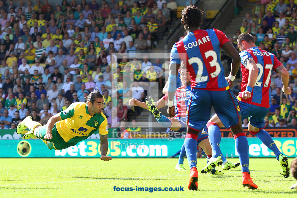 Bradley Johnson of Norwich heads for goal during the Barclays Premier League match at Carrow Road, Norwich<br /> Picture by Paul Chesterton/Focus Images Ltd +44 7904 640267<br /> 08/08/2015