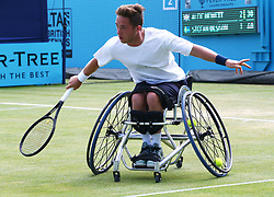 June 23, 2018 - London, England, United Kingdom - Alfie Hewett (GBR ) in action.during Fever-Tree Championships  Wheelchair Event match between Alfie Hewett (GBR ) against Stefan Olson (SWE) at The Queen's Club, London, on 23 June 2018  (Credit Image: © Kieran Galvin/NurPhoto via ZUMA Press)