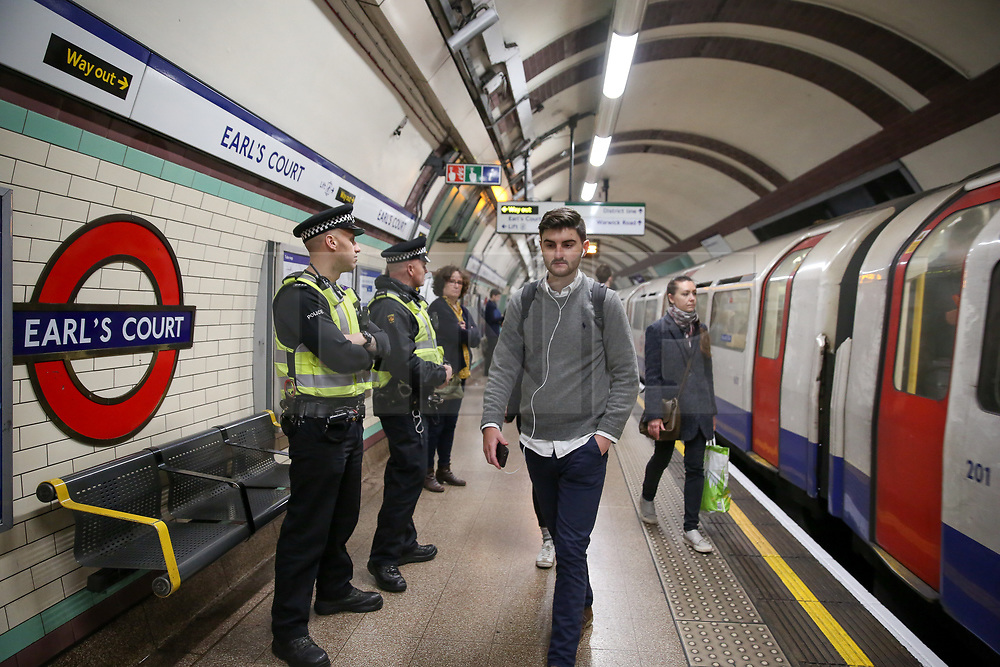 © Licensed to London News Pictures. 17/04/2019. London, UK. British Transport Police Officers at Earl's Court station platform as the Extinction Rebellion group plans to cause disruption on London Underground demanding decisive action from the UK Government on the environmental crisis. Photo credit: Dinendra Haria/LNP