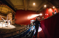 Superintendant Bob Ferguson from Bonnette, Page and Stone walks through as renovation work is being done on the balcony level of the Colonial Theater in downtown Laconia.  (Karen Bobotas/for the Laconia Daily Sun)