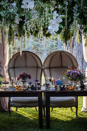 A Bride And Groomu0027s Throne Like Chairs And Place Settings At An Outdoor  Wedding Reception.