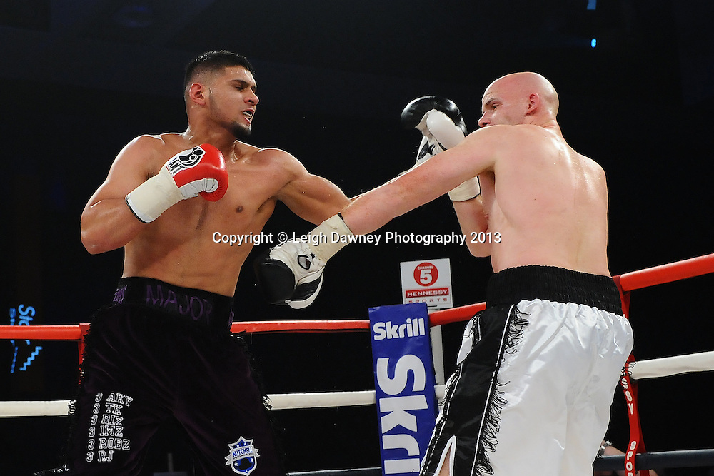 Arfan Iqbal (black shorts) defeats Leon Senior in a Light Heavyweight contest. Glow, Bluewater, Kent, UK. Hennessy Sports © Leigh Dawney Photography 2013.